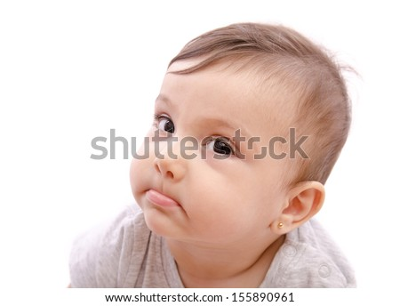 Isolated baby funny expression looking at the view. - stock photo