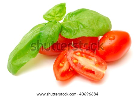isolated baby tomatoes and basil - stock photo