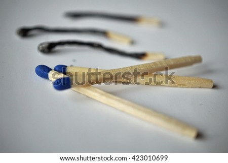 Isolated background with unburnt and burnt safety matches as a symbol of used and new  - stock photo