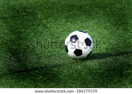 isolated ball on a soccer field.vignette added