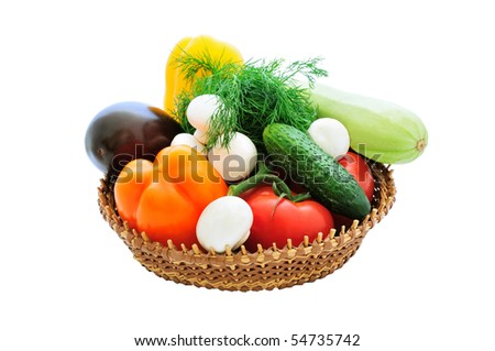 isolated basket of fresh vegetables and mushrooms - stock photo