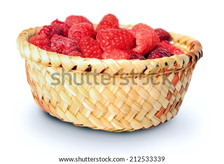 Isolated basket with raspberry on white - stock photo