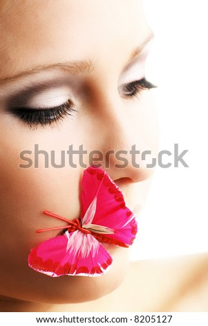 isolated beauty portrait of a young woman with a pink butterfly - stock photo
