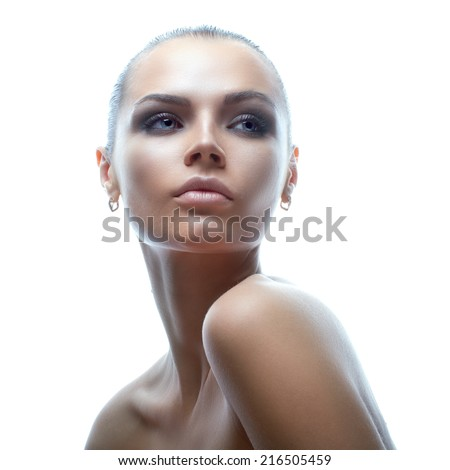 Isolated Beauty Portrait of attractive young model in high-key technique - stock photo