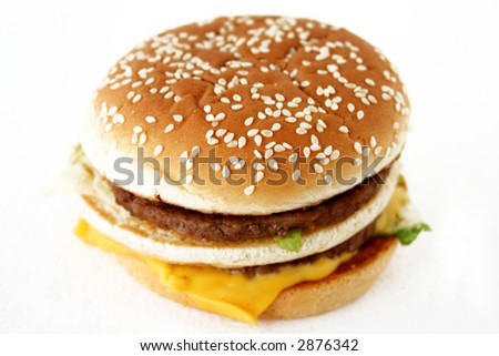 Isolated beef burger with cheese - stock photo