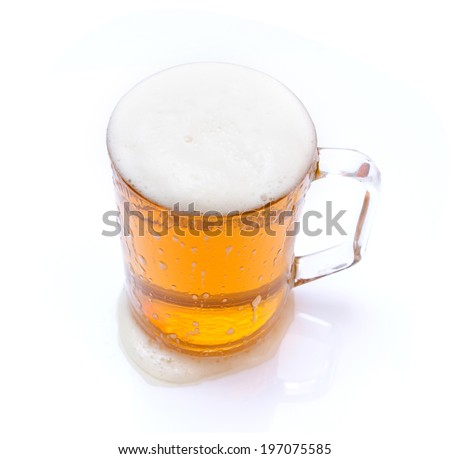 Isolated beer in glass mug on white background
