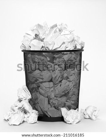 Isolated bin with crumpled paper