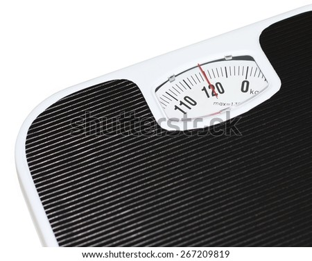 Isolated black and white bathroom scales at 120 kilograms - stock photo