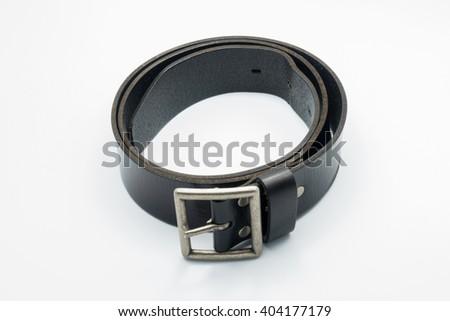 Isolated black belt with white background - stock photo