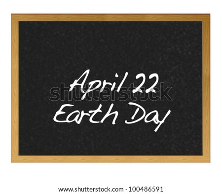 Isolated blackboard with Earth Day. - stock photo