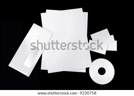 Isolated blank corporate envelope, business cards, pages and cd on black background - stock photo
