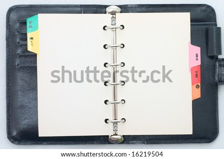 Isolated blank opened organizer. - stock photo