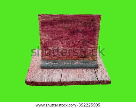 Isolated blank wooden nameplate isolated  isolated on a green background. - stock photo