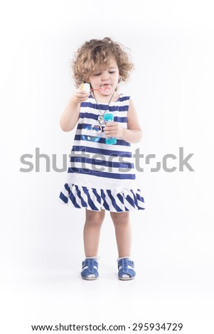 Isolated blonde girl with blue dress