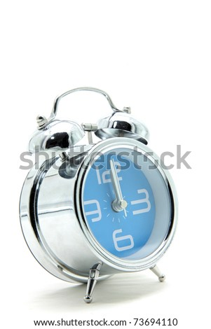 isolated blue alarm clock on white side perspective - stock photo
