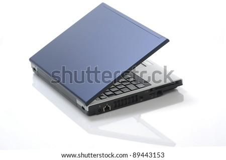 Isolated blue laptop - stock photo