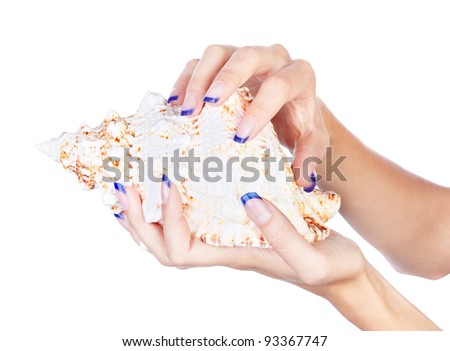 isolated body part shot of beautiful healthy young woman's manicured hands with shell on white