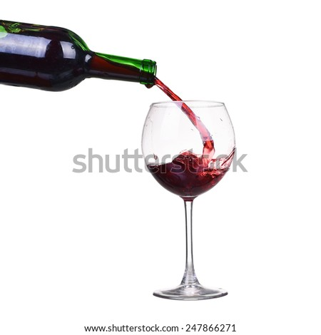Isolated bottle and glass with splash of red wine - stock photo
