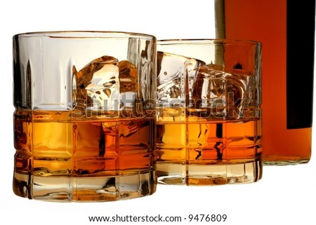 Isolated bottle and glasses of whiskey and ice. - stock photo