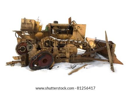Isolated broken bulldozer on snow. - stock photo