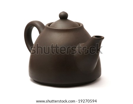 Isolated brown ceramic chinese teapot. White background. - stock photo