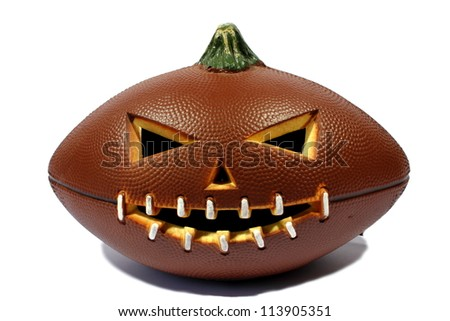 Isolated brown halloween football carved out as a jack o lantern. - stock photo