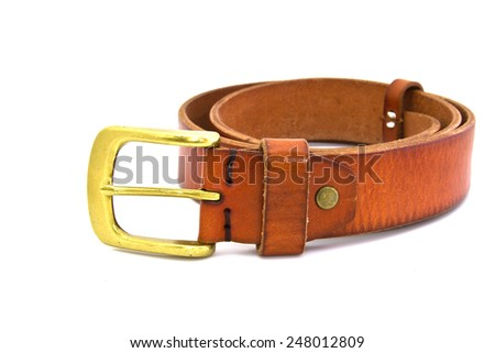 Isolated brown leather belt with brass buckle on white background - stock photo