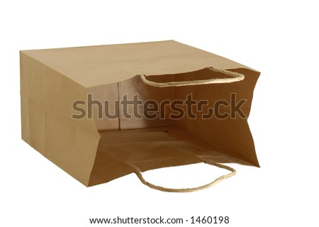 Isolated brown paper gift bag laying on it's side letting you see inside. - stock photo
