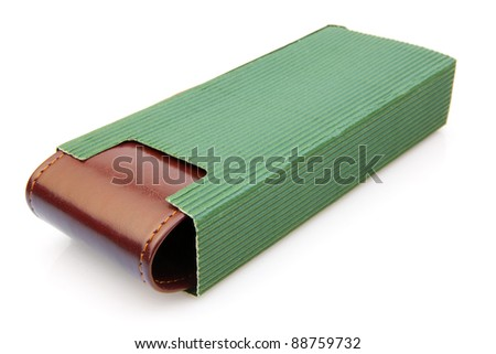 Isolated Brown Pen box in Green Cover - stock photo