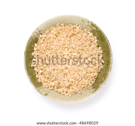Isolated brown rice in bowl, main food of Japanese - stock photo