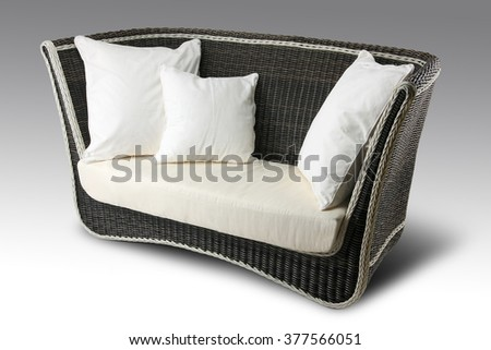 Isolated brown Wicker sofa with white pillows - stock photo