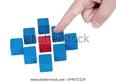Isolated building blocks with pointing finger on white background - stock photo