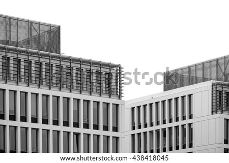 Isolated building windows texture. Black and white modern commercial office building, architectural exterior and white sky above. - stock photo