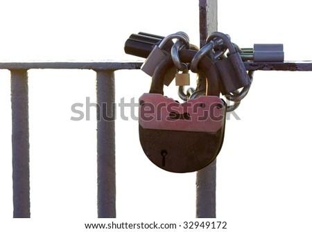 isolated bunch old padlocks on the steel chain and rustic bars with clipping path - stock photo