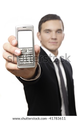 isolated business male holding a cell phone for communication. selective focus on phone - stock photo