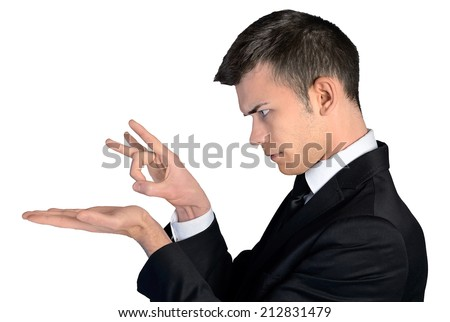 Isolated business man hit with finger - stock photo