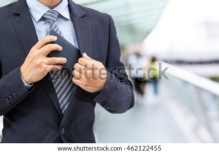 isolated business man hold the smartphone on bridge background