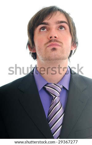 isolated business man in suit look up