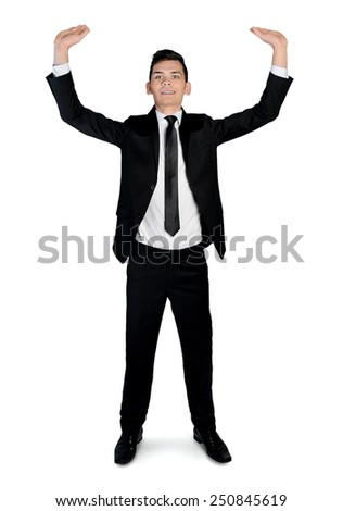 Isolated business man lifting something - stock photo