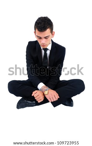 Isolated business man locked with chain - stock photo
