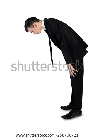 Isolated business man looking down - stock photo