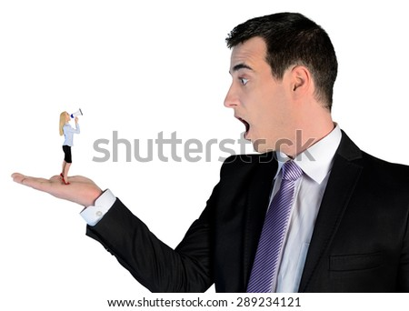 Isolated business man looking shocked on little woman