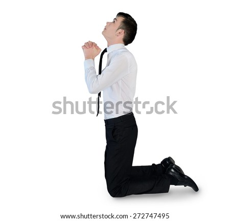 Isolated business man pray looking up - stock photo