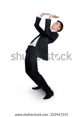 Isolated business man pushing nothing - stock photo