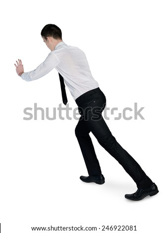 Isolated business man pushing something - stock photo