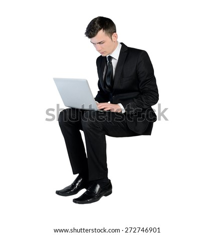 Isolated business man typing laptop