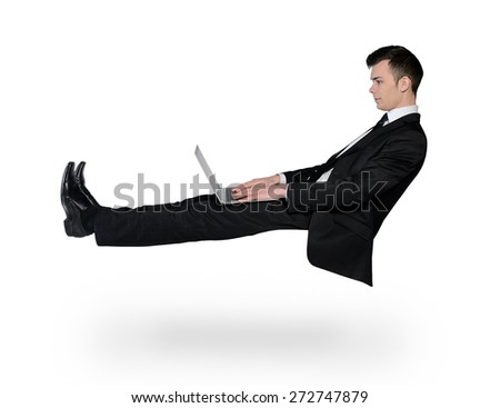 Isolated business man typing laptop - stock photo