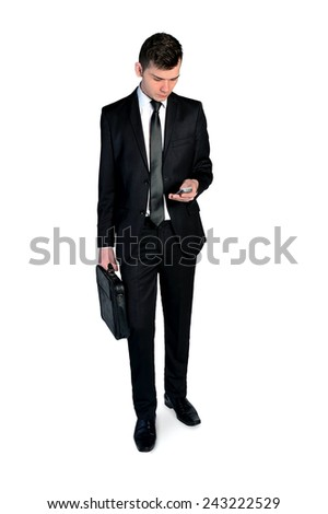 Isolated business man using phone - stock photo