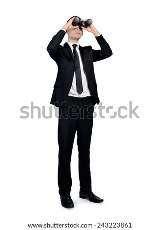 Isolated business man with binoculars - stock photo
