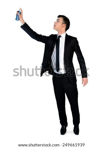 Isolated business man with paint spray - stock photo